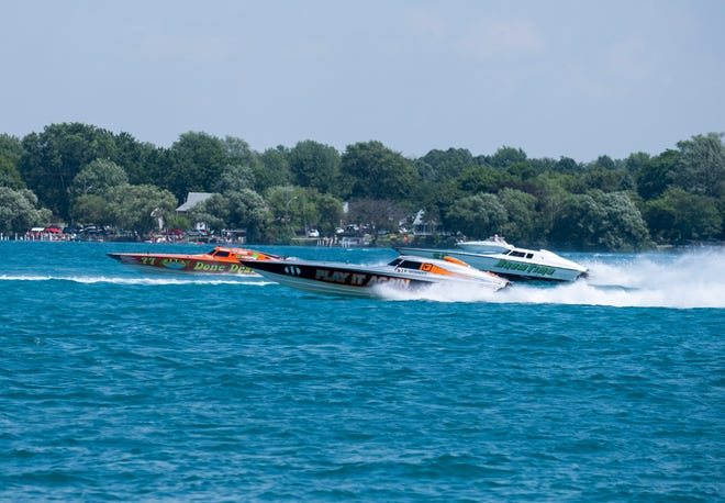 Play It Again, center, passes Done Deal, left, and Show Time as they compete in the St. Clair River Classic Offshore Powerboat Races Sunday, July 27, 2019, on the St. Clair River.