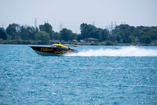 Wazzup, left, pulls away from Strictly Business as they compete in the St. Clair River Classic Offshore Powerboat Races Sunday, July 27, 2019, on the St. Clair River.
