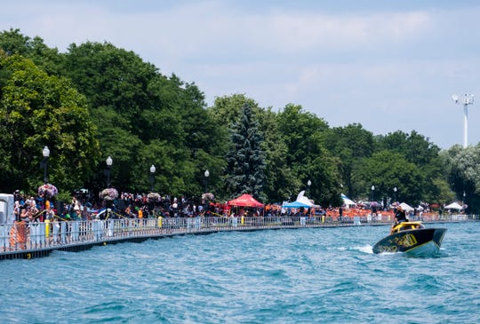 Wazzup takes a victory lap past a crowded Palmer Park after taking the checkered flag in the Class 3 race of the St. Clair River Classic Offshore Powerboat Races Sunday, July 27, 2019, on the St. Clair River.