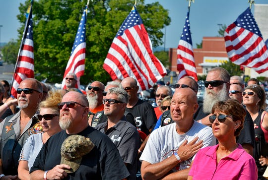 More than 200 motorcyclists takin part in the 16th Annual Bike Run to Benefit Homes for Our Troops stand while the National Anthem is sung, Sunday, July 28, 2019. 