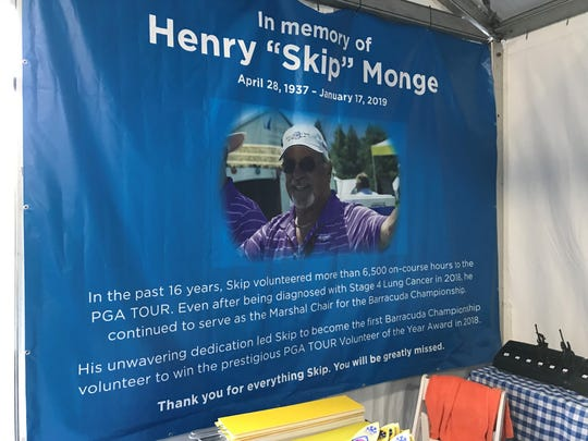 A banner onring long-time volunteer Skip Monge hangs in the volunteer tent at Montreux.