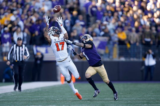 Nov 17, 2018; Seattle, WA, USA; Oregon State Beavers wide receiver Isaiah Hodgins (17) catches a long pass over Washington Huskies defensive back Byron Murphy (1) during the first quarter at Husky Stadium. Mandatory Credit: Jennifer Buchanan-USA TODAY Sports