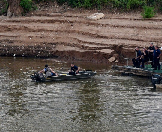 First responders search for woman who reportedly drove car into Red River Saturday evening July 27, 2019.