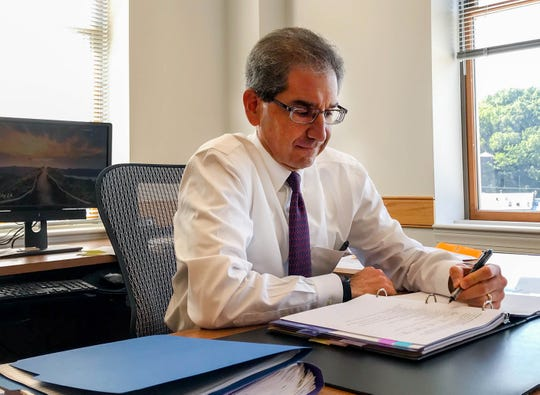 Staunton City Manager Steve Rosenberg works in his City Hall office on July 24.