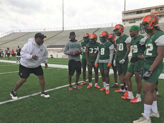 FAMU defensive backs coach Billy Rolle gives instructions to players during spring camp.