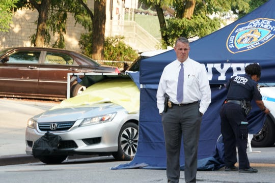Police at the scene where two young children were found dead after being left all day in a hot car on West Kingsbridge Road at Kingsbridge Terrace in the Bronx, NY around 4 p.m. on July 26, 2019.