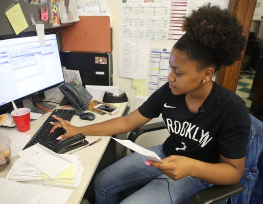 Anyssa Biggs inputs information in the computer at her summer job for the building department at Mount Vernon City Hall July 26, 2019.