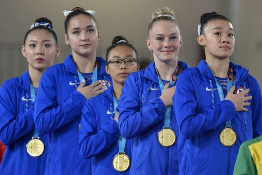 (L-R) USA team Kara Eaker, Aleah Finnegan, Morgan Hurd, Riley McCusker and Leanne Wong are singing the national anthem during the awards ceremony Women's Team Artistic Gymnastics event of the Lima 2019 Pan-American Games in Lima, on July 27, 2019. - Us won gold medal in this event.