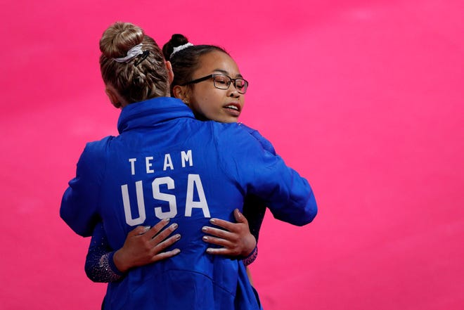 Morgan Hurd of the U.S. gets a hug from a coach after competing on floor in the women's gymnastics qualification and team final at the Pan American Games in Lima, Peru, Saturday, July 27, 2019.