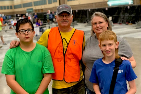 The extended Highley family, Ron and Victoria Highley with their grandchildren Memo Ramirez and Warren Highley at the National Horseshoe Pitching Association's World Horseshoe Tournament in Ray Clymer Exhibit Hall.