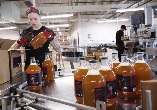 Meg Lahti packages up growlers of NessAlla Kombucha in their production space at the newly renovated Garver Feed Mill on the East Side in Madison, Wis., Tuesday, July 16, 2019.