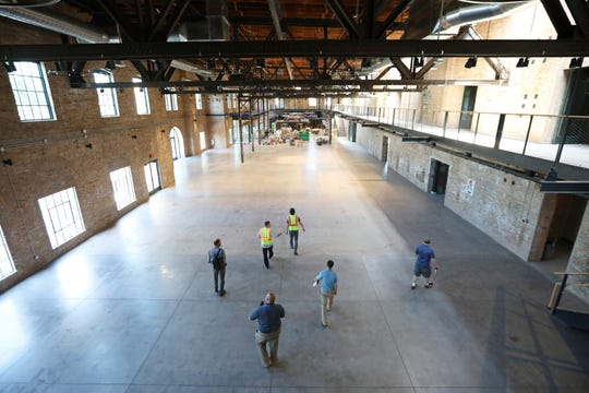 A 13,500-square-foot atrium will serve as an event center in the rebirth of the old Garver Feed Mill on the East Side in Madison, Wis., Tuesday, July 16, 2019. Baum Revision is preparing to reopen the former sugar factory and feed mill this week after an 18-month, $15.5 million renovation.