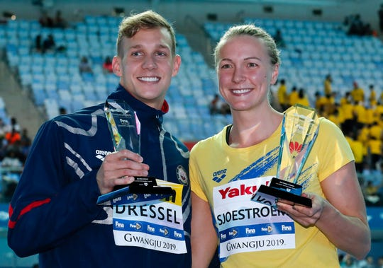 United States' Caeleb Dressel, left, and Sweden's Sarah Sjsotrom pose with their trophies for top male and female swimmers at the World Swimming Championships in Gwangju, South Korea.