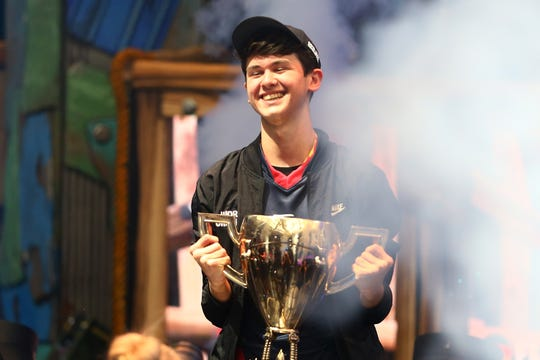 "Kyle ""Bugha"" Giersdorf celebrates after winning the Fortnite World Cup solo final at Arthur Ashe Stadium in New York City."