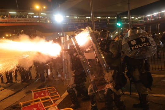 Police fire tear gas on protesters taking part in a demonstration against what activists say is police violence in Hong Kong on July 28, 2019.