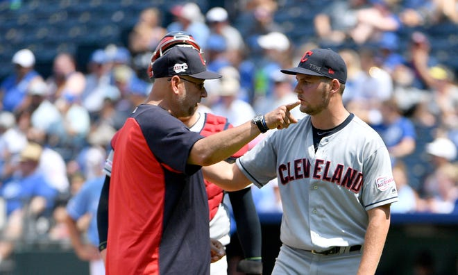 Indians manager Terry Francona makes an emphatic point to pitcher Trevor Bauer after removing the right-hander from Sunday's game against the Royals in the bottom of the fifth inning.