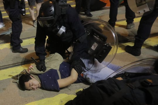 Police detain protesters after charging at them near the China Liaison Office after a protest against what activists say is police violence in Hong Kong on July 28, 2019.