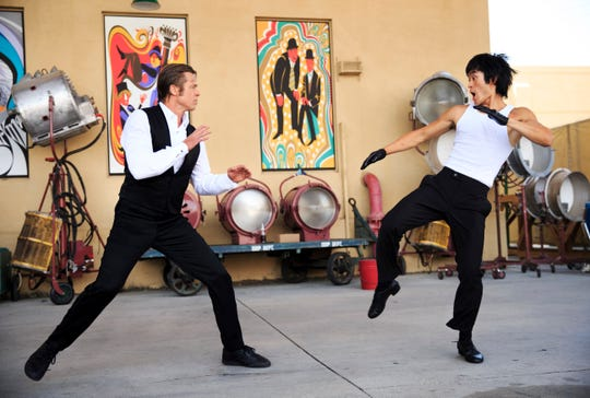 "Cliff Booth (Brad Pitt) and Bruce Lee (Mike Moh) fight it out in ""Once Upon a Time in Hollywood."""