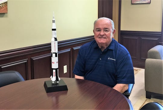Woodworth Mayor David Butler with a model of the spacecraft that landed astronauts on the moon for the first time. Five decades ago, Butler worked on The Saturn V rocket that powered the Apollo 11 mission.