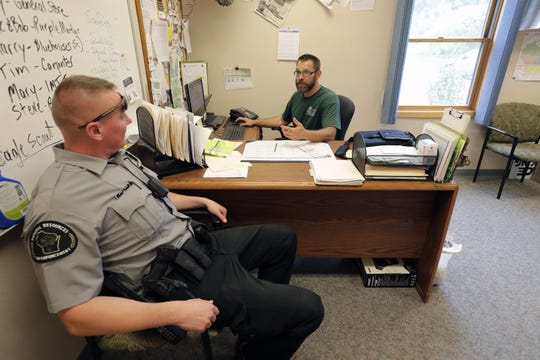Ranger Jeff Nieling, left, talks with Park Ranger Jay Vosters Friday, July 26, 2019, at High Cliff State Park in Sherwood, Wis. Neiling is with the Bureau of Law Enforcement.