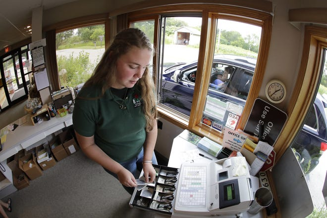 Summer limited time employment employee Brooke Brouillard sells an annual pass to a resident at the park office of High Cliff State Park Friday, July 26, 2019, in Sherwood, Wis.