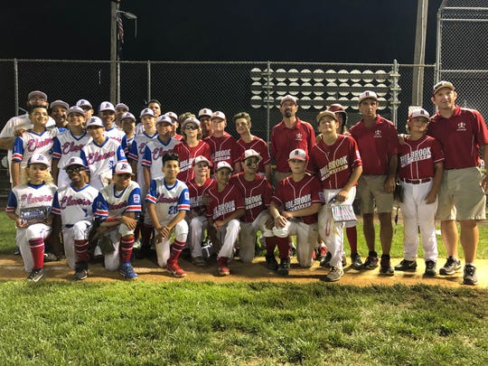 In an outstanding display of sportsmanship, the Elmora Youth and the Holbrook teams, managers and coaches pose for a photo following the championship game on July 28, 2019