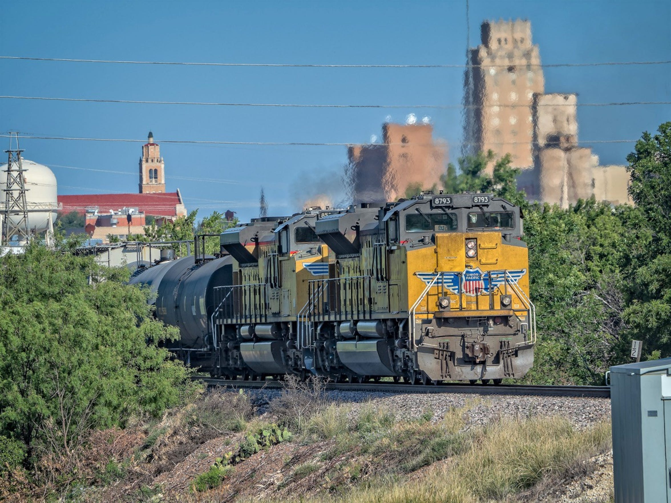 A Union Pacific train  makes it way east out of downtown Abilene,