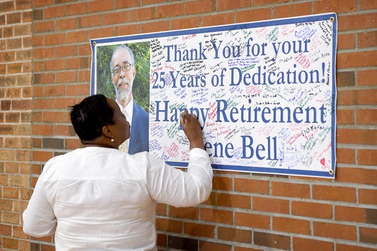 Priscilla Robinson, a member of the South Side Community Advisory Board, signs a poster at a retirement party for Gene Bell, who served as the director of the Asheville Housing Authority, at the Arthur R. Edington Center on July 25, 2019. Robinson worked with Bell to save the building that is now the Edington Center and transform it into a community space.