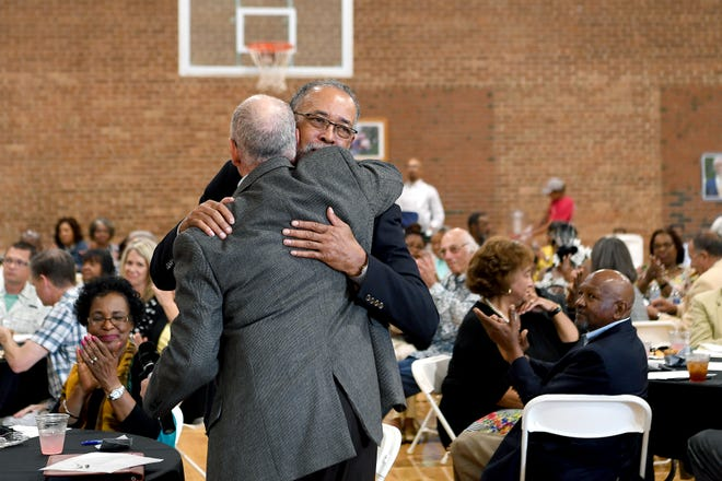 Gene Bell hugs David Nash after Nash presented him with a gift at his retirement party at the Arthur R. Edington Center on July 25, 2019. Bell retired from the Asheville Housing Authority after 25 years and Nash will be taking over his role as CEO.