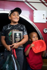 Jayden Castillo, 9, stands with Marlee Shelton, 5, as he is honored at Asheville Fire Department Station 5 on July 29, 2019. On June 30, 2019 Jayden pulled an unconscious Marlee from the bottom of an apartment complex swimming pool allowing adults to perform CPR before help could arrive, saving his life.