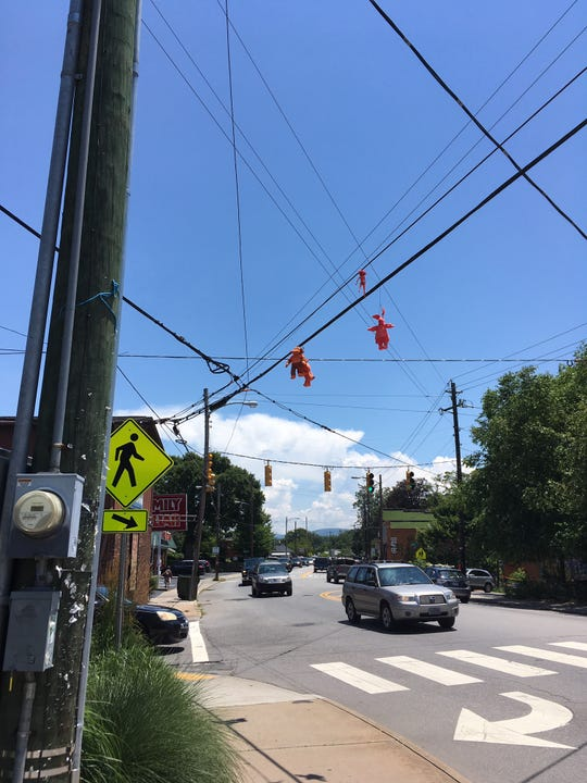Duke Energy recently removed these dolls from utility lines on Haywood Road in West Asheville.