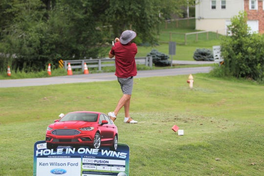 Owen alumnus Jesse Gardner tries to sink a hole in one on the third hole at the Black Mountain Golf Course during the 33rd annual Warhorse Classic.