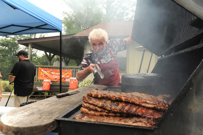 Mike Raines tends to the grill at the 33rd annual Warhorse Classic.