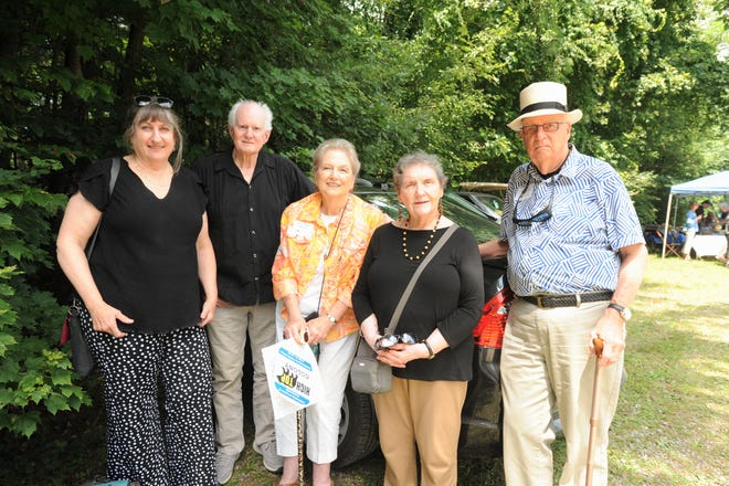Sally Folger Thomas, center, grew up going to the cabin her father built in High Top Colony in 1919. Her family sold the cabin to the mother of Gloria McDonald, right center in 1962. McDonald and her husband Arthur, right, sold the cabin to current owners Frank Rupp, left center, and Cynthia Montague in 2015.