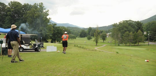 Golfers tee off on the 10th hole at the Black Mountain Golf Course on July 27 for the 33rd annual Warhorse Classic.