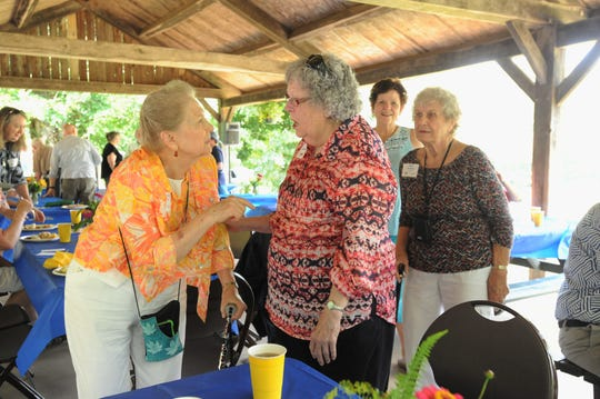 Sally Folger Thomas, left, and Elaine Loutzenheiser were named lifetime members of High Top Colony at a ceremony celebrating the community's 100th anniversary.