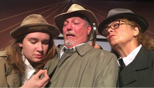 Detectives Alberta Finney (Karen Monks) and Terry Reed (Kattie McCall) grill potential witness Detective Sam Shovel.