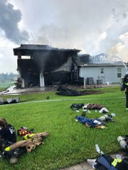 A garage fire was reported about 2:30 p.m. Monday on Province Drive. A woman and two children inside the home managed to escape as flames spread through the residence