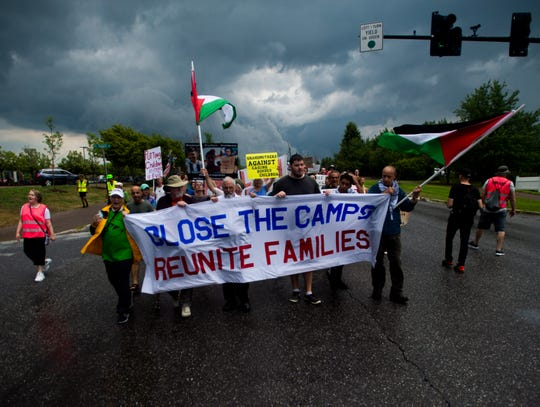 Protestors march to the Williston U.S. Immigration and Customs Enforcement  on Sunday, July 28, 2019.
