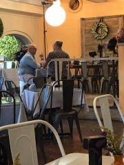 Award-winning chefs Andrew Zimmern and Michel Nischan talk on camera at Hester's Cafe in Lamar Park in Corpus Christi on July 29, 2019.
