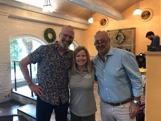 Restaurant owner Hester Rodriguez stands with award-winning chefs Michel Nischan and Andrew Zimmern on July 29, 2019.