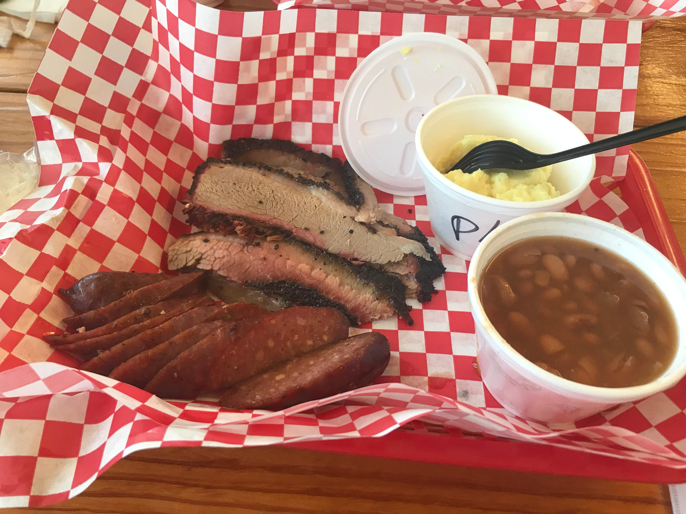 A two-meat plate with potato salad and pinto beans from Julian's BBQ in Corpus Christi.