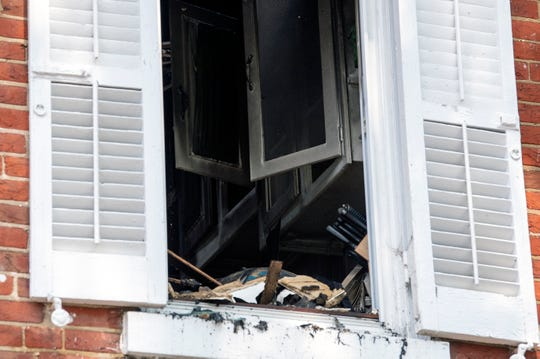 Damage from an apartment fire at the intersection of Broad St and Buttonwood St Monday, July 29, 2019 in Mount Holly, N.J.