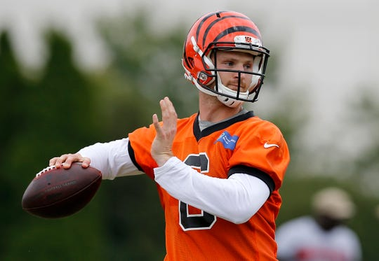 Cincinnati Bengals quarterback Jeff Driskel (6) drops back to throw a pass during practice on day three of training camp at the Paul Brown Stadium practice field in downtown Cincinnati on Monday, July 29, 2019.