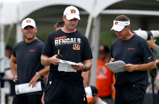 Cincinnati Bengals head coach Zac Taylor sets up for the next session during practice on day three of training camp at the Paul Brown Stadium practice field in downtown Cincinnati on Monday, July 29, 2019.