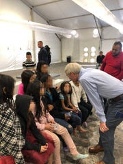 Sen. Rob Portman, R-Terrace Park, talks with families from El Salvador, Guatemala and Honduras, during a recent visit to the Donna processing facility in McAllen, Texas. After seeing the humanitarian crisis at the southern border firsthand, Portman said he is more committed than ever to working with Democrats to fix America's broken immigration system.