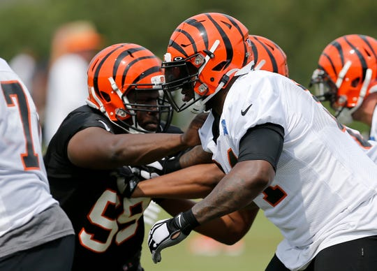 Cincinnati Bengals defensive tackle Andrew Billings (99) and offensive tackle John Jerry (64) face off on a play during practice on day three of training camp at the Paul Brown Stadium practice field in downtown Cincinnati on Monday, July 29, 2019.