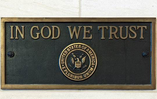 Kenton County School District ordered 20 of these bronze plaques displaying the nation's motto to comply with new state law. They will be hung prominently in each school.
