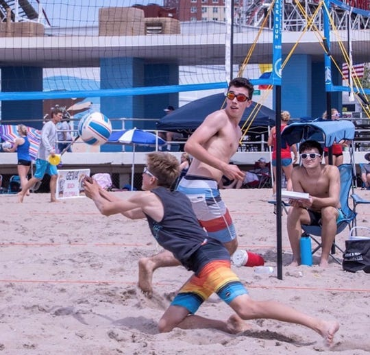 Christian Trevino, standing, and Jay Hyman placed in the 2019 USA National Beach Tour Junior Championships