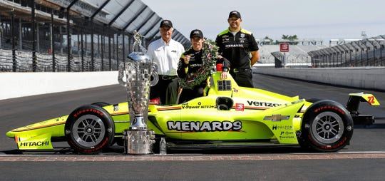 Roger Penske, driver Simon Pagenaud and mechanic Colin Davis of West Lafayette after Team Penske won the famed Indianapolis 500 in May, shortly after Davis joined the crew.